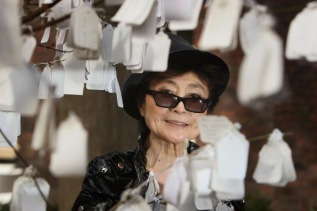 LIVERPOOL, UNITED KINGDOM - APRIL 04: Yoko Ono poses next to 'The Wish Tree', one of her art installations at The Bluecoat Display Centre on April, 2008 in Liverpool, England. The Wish Tree invites viewers to write their wishes on labels that are then fixed to the branches. Yoko Ono returned to perform and display her art at The Bluecoat 40 years after she first exhibited there in 1967 to celebrate the re-opening of the UK's oldest arts centre after a GBP 12.5 million refurbishment. (Photo by Christopher Furlong/Getty Images)